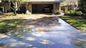 driveway before pressure wahing in cobbs landing palm harbor