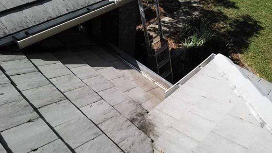 clean gutter on tile roof