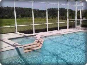 pressure washing odessa-pool deck-cage